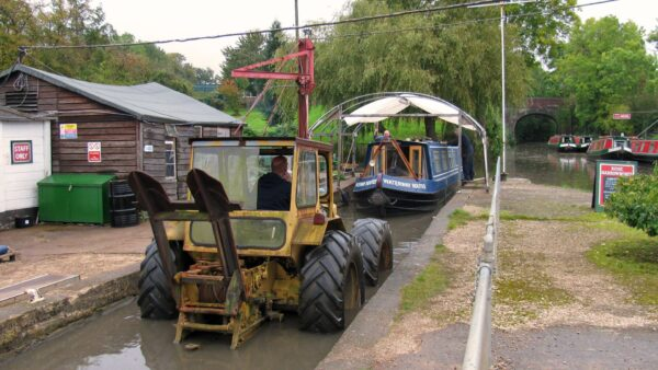 Floating onto the trailer ready to go into the paint shed at Rose Narrowboats