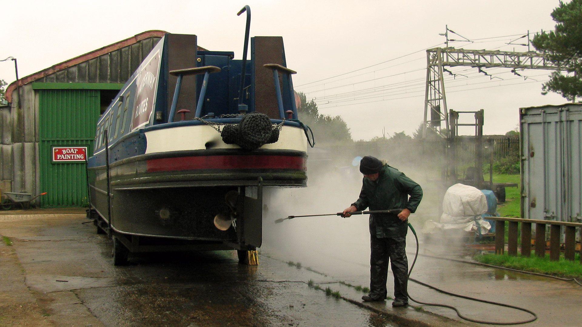 Pressure washing the stern.