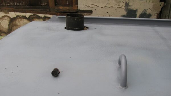 Chimney exposed and holes welded up