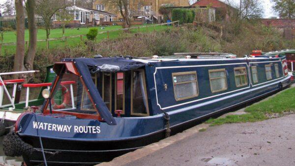 > Repainted Waterway Routes Narrowboat moored at Rose Narrowoboats