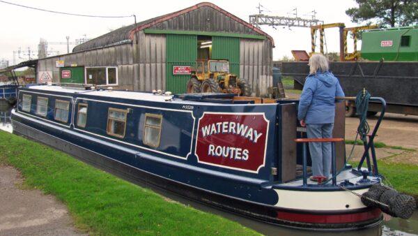 Repainted Waterway Routes Narrowboat leaving Rose Narrowboats